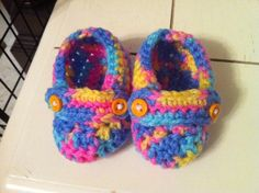 Posh booties - Rainbow with orange buttons.