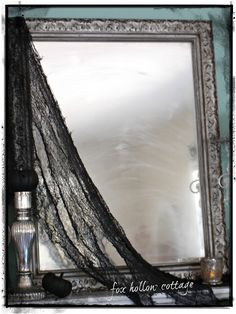 A light coat of hairspray dusted with baby powder adds a nice old spooky feel to a mirror. Extra layers of both gets it hazier. This will make a great effect for the edges of my bathroom mirrors!