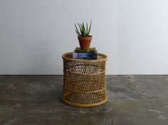 This lovely rattan/wicker side table is in wonderful vintage condition. Lightweight and sturdy with no breaks to the wicker. This versatile piece will make