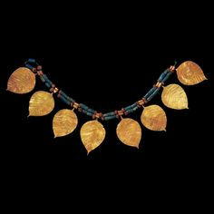 Headdress and necklace of gold, lapis lazuli and cornelian     Woolley's greatest discovery at Ur was the so-called 'Royal Cemetery', which he began to excavate from 1926. Dug outside the walls of the city, the cemetery was built over by the walls of Nebuchadnezzar's larger city about 2,000 years later. Some 1,840 burials were found, dating to between 2600 BC and 2000 BC. They ranged from simple inh...