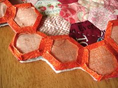 Photos and tips for edging a hexie quilt