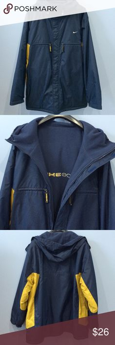 Men's Reversible Nike Jacket Great condition reversible hooded coat. Navy blue and yellow. Pockets on both sides and Fleece on the inside. Nike Jackets & Coats