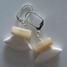 Inuit made ivory & muskox horn ulu style earrings via Nikol Campaugh