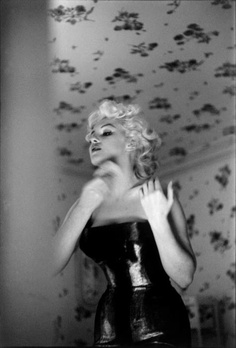 Marilyn Makeup, I have a print of her putting her eye liner on. I think I am going to get this as a print n pair them up.