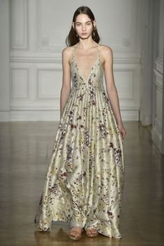 Nina Garcia's Favorite Looks from the Spring 2017 Couture Runway Nina loved this look by Valentino! A clean-cut deep V-neck gives upholstery-grade fabric surprisingly youthful appeal.