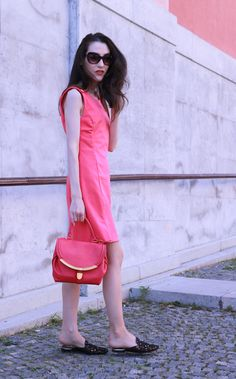 Fashion blogger Veronika Lipar of Brunette From Wall Street sharing how to wear head to toe peachy pink outfit this summer