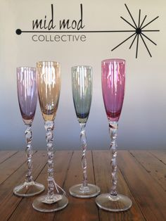 Vintage twist stem champagne glasses with AB finish. Available now at Mid Mod Collective. Email midmodcollective@gmail.com for more info. SOLD!