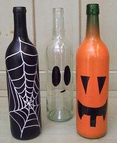 Make Halloween decorations out of empty wine bottles!