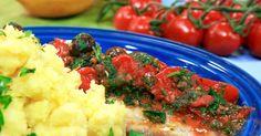 Sej som tillagas i ugn och serveras i en mustig tomatsås med oliver och kapris. Pressad blomkål med citron passar perfekt till.