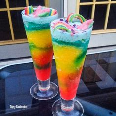 THE DRUNKEN CANDY MAN Red Layer*** Strawberry Daiquiri Mix Strawberry Liqueur (AKA SWEET REVENGE!) White Rum  Yellow Layer*** Mango Daiquiri Mix Peach Schnapps Gin  Blue Layer*** Vodka Blue Curacao Pineapple Juice  Candies*** Sour Watermelon Sharks Airheads Xtreme Nerds