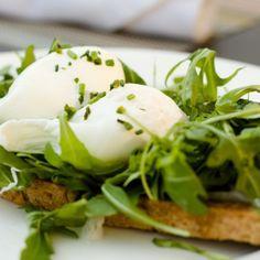 Greens, Eggs & Ham at Cafe Osage.  Poached eggs atop arugula & prosciutto over whole wheat crostini.