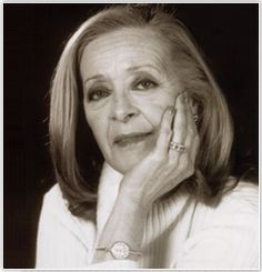 """Simone de Oliveira, born on February 11th, 1938, is a Portuguese singer and actress. Best known for her song """"Desfolhada"""" (vide video) at the Eurovision Song Contest, in 1969, is also known for her true, strong hard-working woman personality, whose presence in stage is one of a kind. She is a straight-forward speaker, who doesn't show any problem in saying what she thinks; she speaks from her heart. She also is a breast cancer survivor. By Lúcia"""