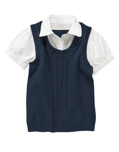 Cable sweater vest with inset styling for a preppy layered look.