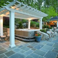 This backyard has it all. Firepit, pool, poolhouse, 3 season porch, upper deck with stone pavers, Pergola with hot tub, pond, pavilion with outdoor kitchen and pizza oven