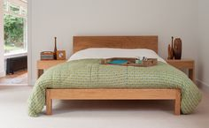 The Malabar is a contemporary wooden bed. Available in a range of solid timbers such as pine, oak and walnut. Made in the UK. Buy online. Free UK Delivery.