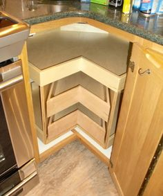 Corner Cabinet Solutions The Glide Around Unit Combines Best Of Shelfgenie S Lazy Susan With Our Pull Out Shelves