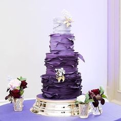 Layered in ruffles of Ultra Violet - this new year's color that is about to take over! Photo: @fionakellyphoto| Cake: @cakesbykrishanthi | Florals: @blueskyflowers | Planner @extraordinarydays