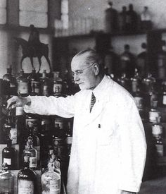 Jacques Guerlain (third generation of the French perfume house Guerlain) in front of his perfume organ.