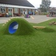This eclipse tunnel mound is a fun addition to nursery playground equipment that is designed