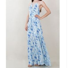 Maxi dress A gorgeous watercolor printed halter maxi dress. Keyhole opening in the front. Zipper closure on back. Dresses Maxi