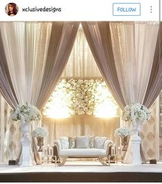 I like the draping colors and design. Instead of the floral wall have one hanging chandelier and replace those tables with lucite ones Reception Stage Decor, Wedding Reception Seating, Wedding Stage Decorations, Backdrop Decorations, Wedding Spot, Desi Wedding, Wedding Halls, Wedding Rings, Decoration Buffet