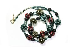 Necklace made of beads - crescent, superduo, triangle, toho, lava stone