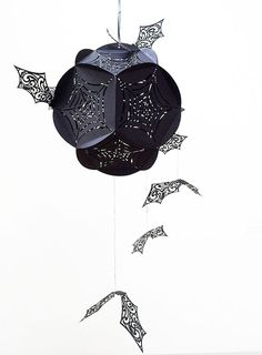 Make this spooky bat sphere to add to your Halloween decor. It's easier than you might think!