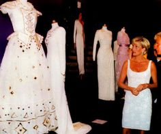 June 25, 1997 - Diana auctions off dresses to raise $4.5 millions for AIDS and cancer research. (Photo: dianaforever.com)
