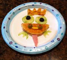 Frog Prince (Grilled ham & cheese,cucumbers,black & green olives,ham for tongue)