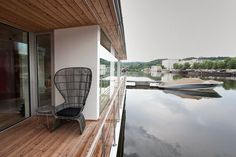 Seen here dockedinPrague's Charles River, thePort X model isa buoyant modular dwelling thatcan be adapted to fit afamily on a1076-square-footfloor plan with a 538-square-foot terrace.  Courtesy of Filip Jandourek.  This originally appeared in Floating Prefab Concept Rethinks the Houseboat.