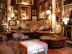Kenneth Jay Lane---Earth colors with a touch of pink, art collection, corner sectional, books, books, books  Love the pile of pillows!