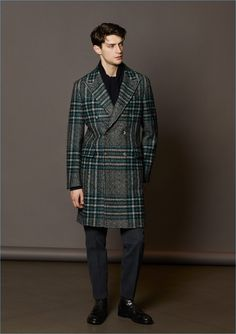 Model Matthew Bell dons a check double-breasted coat by Boglioli.