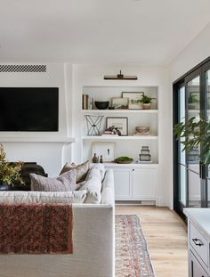 Home Interior Design Love this warm and inviting California living room design with built in shelving and black framed door from Amber Interiors Home And Living, Interior Design, House Interior, Living Room Decor, Home Living Room, Home, Cheap Home Decor, Interior Design Living Room, Interior