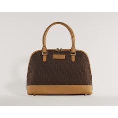Adorable handbag in the classic fabric by DKNY. With this round satchel you get a spacious and exclusive handbag.   (Brun DKNY Saffiano Leather Round Satchel Taske)
