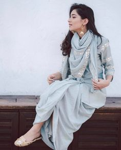 Keeping it traditional with a short kurta, juttis, a pair of balis & a dhoti skirt. We love ethnic, deep-rooted styles with a contemporary… Designer Kurtis, Designer Dresses, Pakistani Dresses, Indian Dresses, Indian Outfits, Indian Clothes, Indian Sarees, Indian Attire, Indian Ethnic Wear