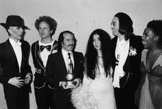 L to R: David Bowie, Art Garfunkel, Paul Simon, Yoko Ono, John Lennon and Roberta Flack, attending the Grammy Awards at the Uris Theater, New York, March 1st 1975.