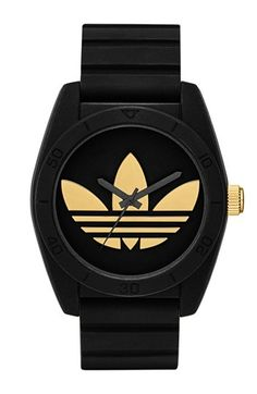 adidas Originals 'Santiago' Polyurethane Strap Watch for men - A prominent case gives a retro look to a glossy monochromatic watch dominated by a contrasting logo on the numberless sunray dial at Nordstrom. Retro Watches, Watches For Men, Wrap Watches, Black Watches, Nice Watches, Adidas Originals Watch, Black And Gold Watch, Black Gold, Adidas Watch