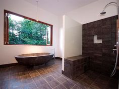 Modern bathroom design with bi-fold windows using tiles - Bathroom Photo 480152