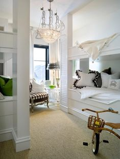 source: Joy Tribout  Fun boys' bedroom with Canopy Designs Ship Chandelier, sisal rug, white built-ins and white & black pillows with gingham trim.