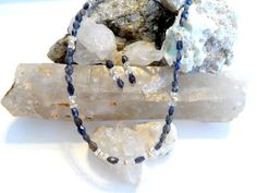 Iolite also known as water sapphire quartz and 14k gold filled beads.  This item has sold but something similar could be made.