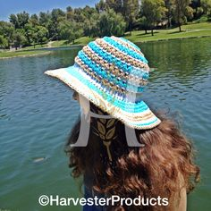 Many crocheters abandon their yarn and hooks during the summer, saving the crochet for cooler weather. But there are plenty of summer-friendly projects out there that are not just quick but also great for a day at the beach. Crochet Hat For Women, Crochet Hats, Wrist Warmers, Hats For Women, Ladies Hats, Boot Cuffs, Summer Hats, Yarn Crafts, Sun Hats