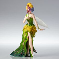 Disney Showcase Tinker Bell Masquerade Couture de Force Figurine New With Box Tinker Bell hides behind a delicate butterfly mask that can rotate to show Tink's true beauty. Disney Couture de Force cel