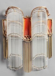 HECTOR GUIMARD Art Nouveau gilt bronze and glass sconce