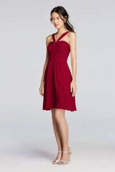 Flirty and fun, this is the dress your bridesmaids will want to wear again!  Y-neck halter bodice features elegant pleated detail with a short crinkle chiffon skirt.  Fully lined. Imported. Back zipper. Dry clean only.  Also available in Extra Length sizes as Style 2XLW10943.  To protect your dress, try our Non Woven Garment Bag.