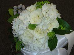 White roses, hydrangea and berries