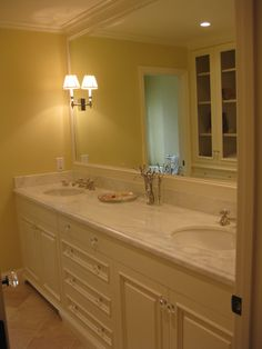 Room expanded to for wider sink area.  Like over all design.