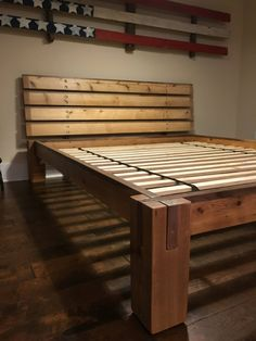 Notched cedar and walnut timbers easily stack together with no tools to make a solid bed frame. Fully loaded with a steel center beam, planks to support mattress. Headboard requires 1/2 wrench or socket. SprayCoated in satin lacquer .