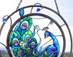 I specifically want a stained glass peacock window. Something in gorgeous, deep tones like this.