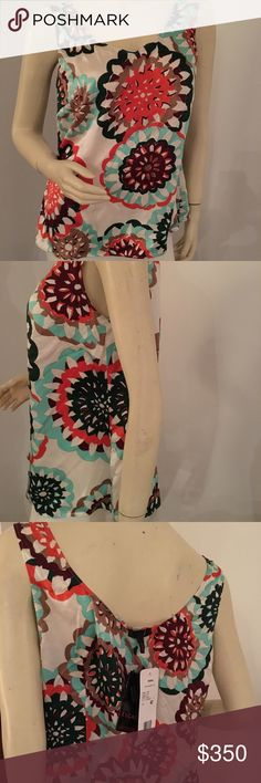 """Escada Silk kaleidoscope Pattern tank Escada 100% high quality silk tank top in a multicolored kaleidoscope pattern. Excellent condition with original tag.                            German size 42.                                              Bust: darts at sides, 41"""" side to side Waist: about 39""""  2 vertical darts on back  Length: about 2 Escada Tops Tank Tops"""