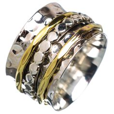 "Solid Sterling Silver and Bronze Spinner Ring DETAILS: * Size 6 1/2 & 7 1/2 * 5.4 g total weight * SOLID .925 Sterling Silver * Stamped .925 * Measures approximately 1/2"" wide Spinner Rings are also c"